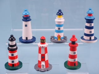 Assortment of six small lighthouses in blue, red and white combinations. 8cm