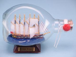 SS Great Britain in Dimple Bottle on a wooden stand with metallic nameplate. 12 x 17cm.