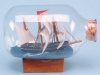 Wooden Ship in Bottle - 7cm on a wooden base.