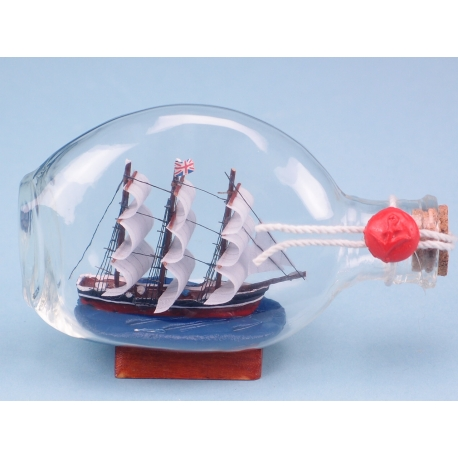 Wooden Ship in Dimple Bottle. Wax sealed. 13cm long.