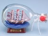 Wooden Cutty Sark in Dimple Bottle. Wax sealed on a wooden stand with a metallic name plate. 15cm