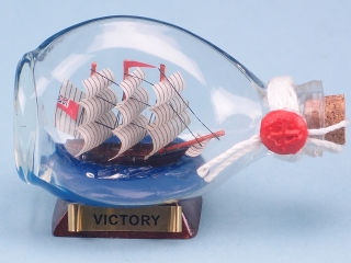 Victory in Mini Dimple Bottle. 9cm. On a wooden stand. Wax sealed.