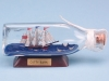 Cutty Sark in Triangular Bottle. 12cm. On a wooden stand with a metallic name plate.