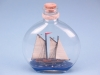 Ship in Round Upright Bottle, sealed with a cork. 14cm