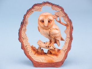 Wood effect owl in log