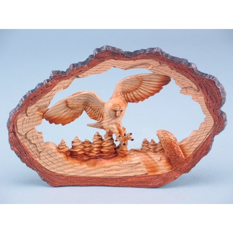 Wood effect flying owl in log