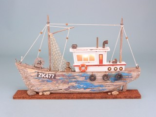 Rustic fishing boat with LED light